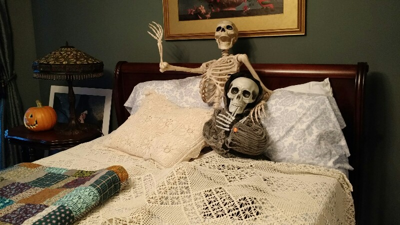 skeletons in bed.jpg