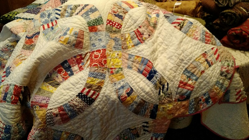 hand quilted vintage quilt.jpg