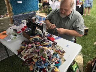 Jerry sewing rug balls 2017 Art in the Park.png