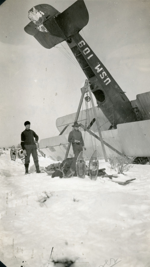 air mail personnel righting of 109 in 8-feet of snow at foot of mt. ro.jpg
