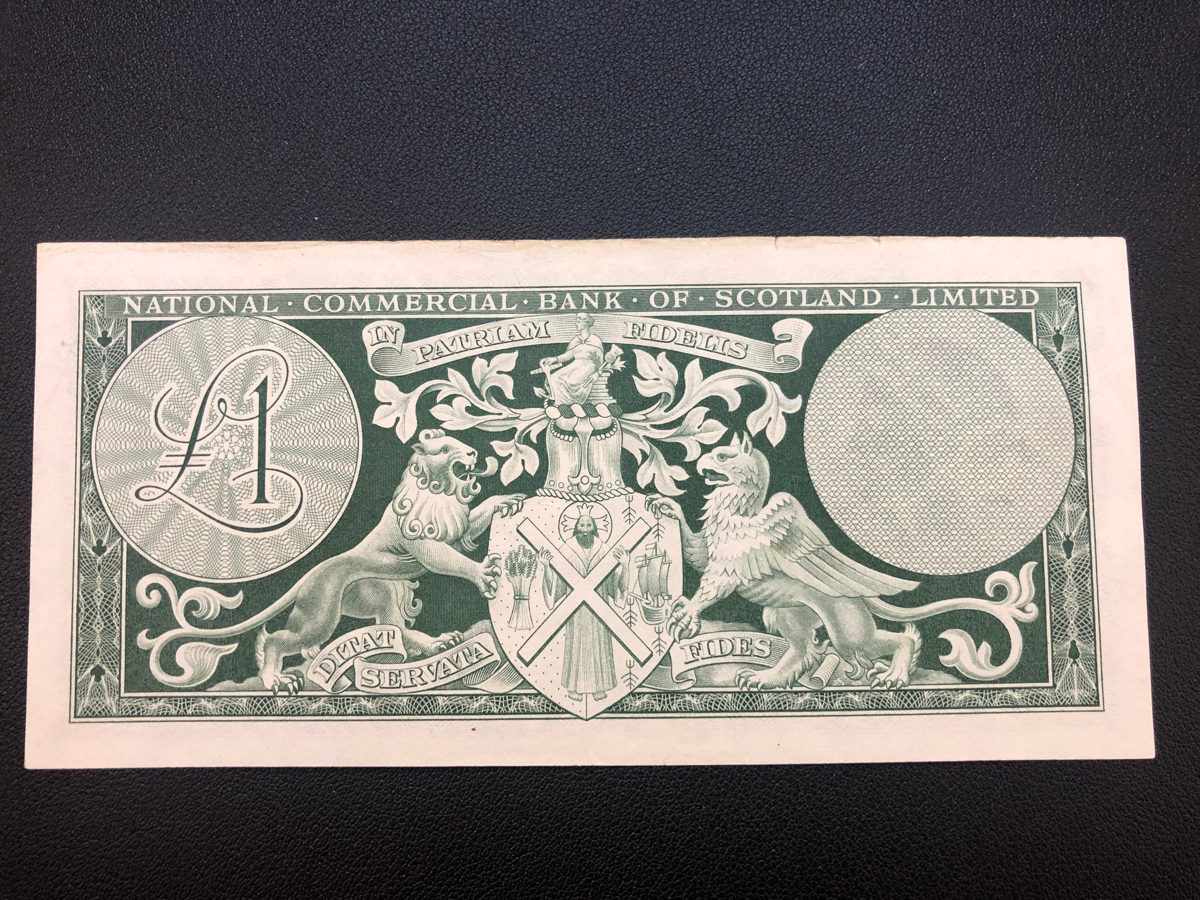Scotland  1 Pound 1963 269a National Commercial Bank AU with top nick .jpg