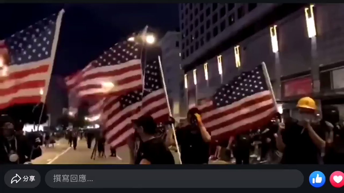HK Protesters wave American Flag and chant US national anthem.jpg