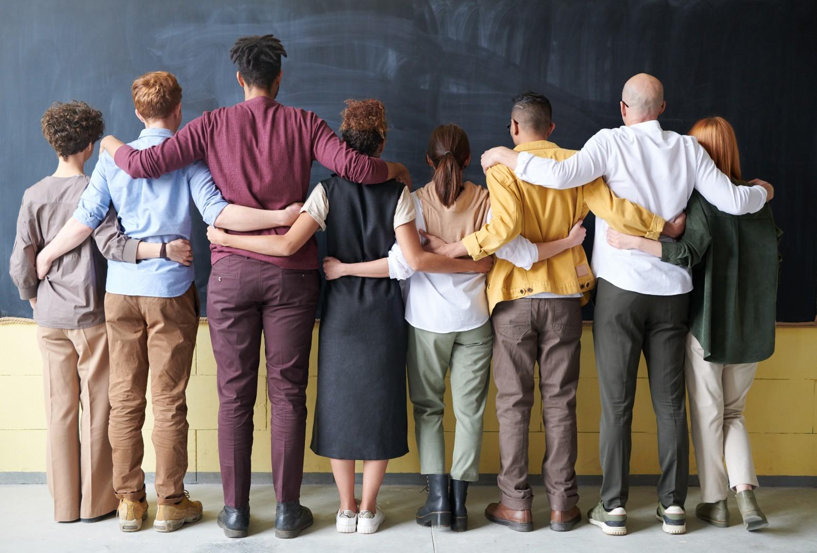 group-of-people-standing-indoors-3184396.jpg